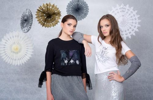Ruxandra wearing a Snowflakes Sweatshirt, Andra wearing a Spot Snowflake T-shirt